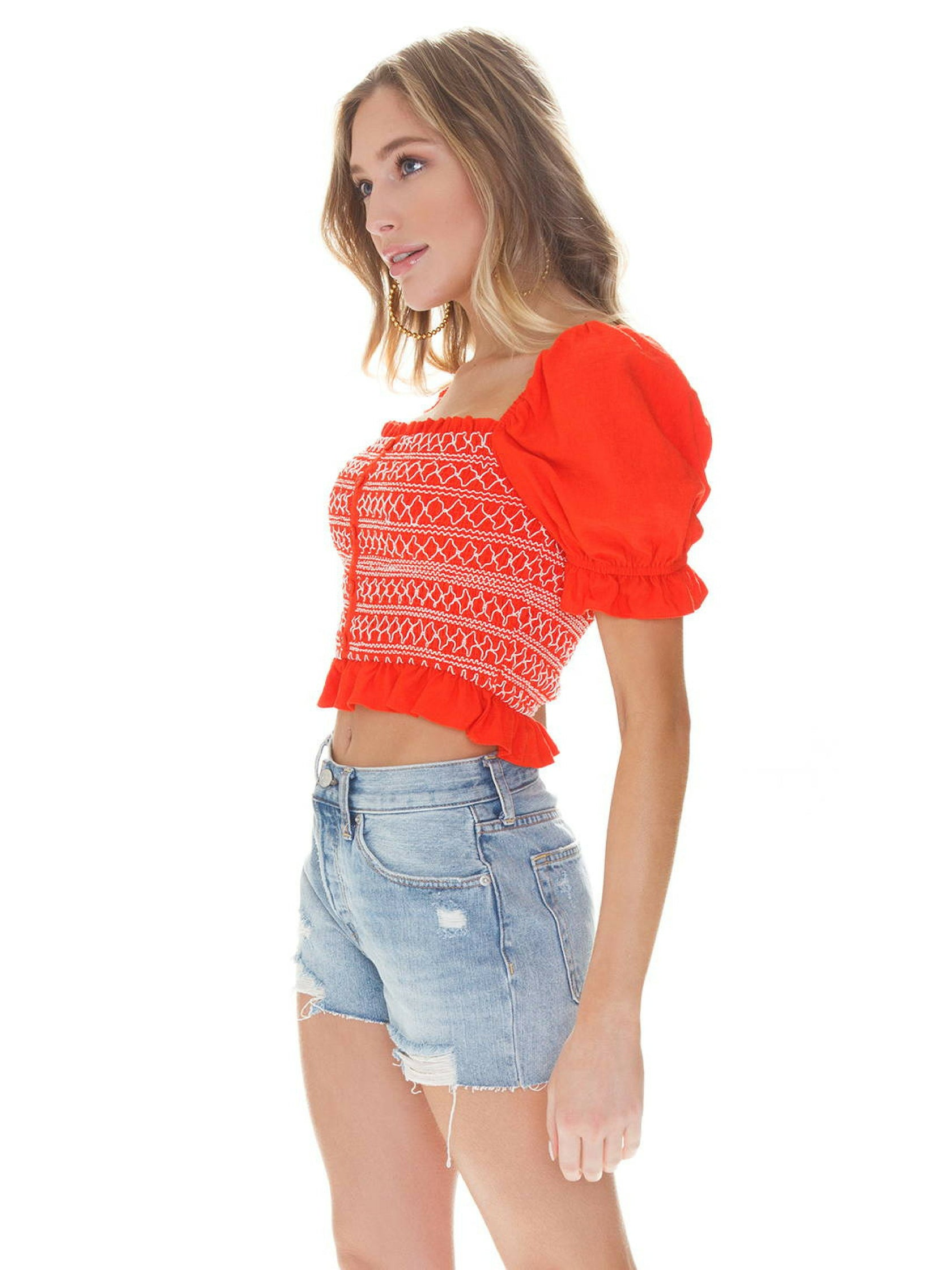 Women wearing a top rental from LOST + WANDER called Bloody Mary Smocked Top