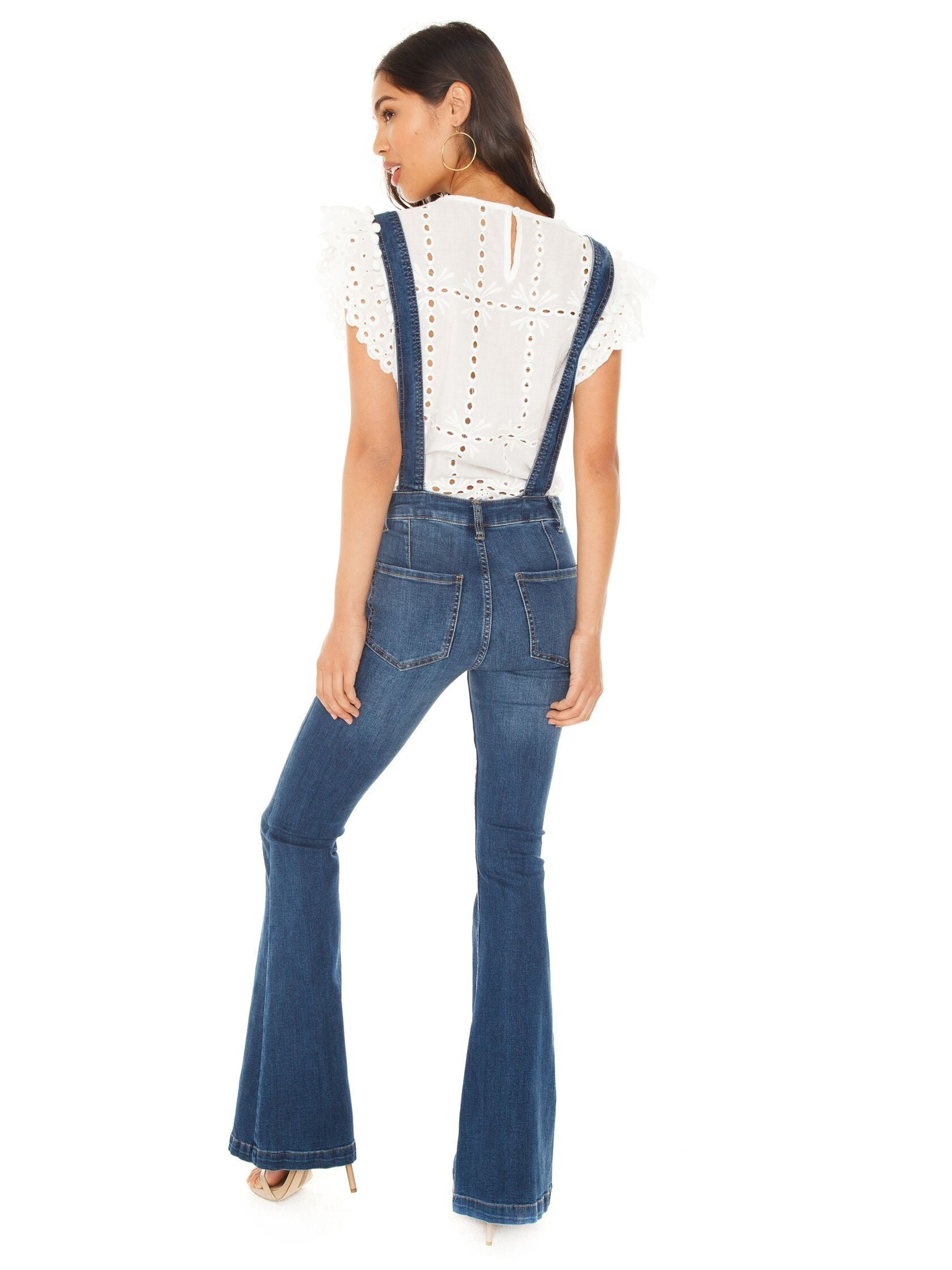 Women wearing a overalls rental from Free People called Carly Flare Overall