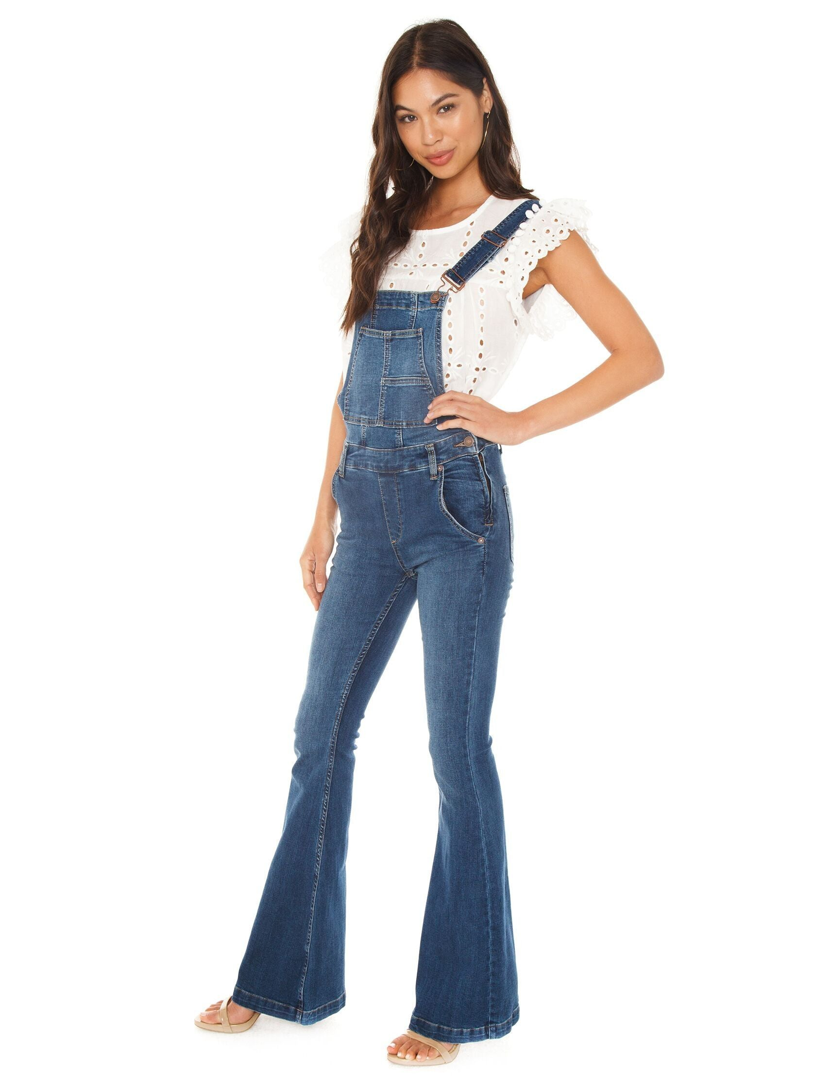 Woman wearing a overalls rental from Free People called Carly Flare Overall