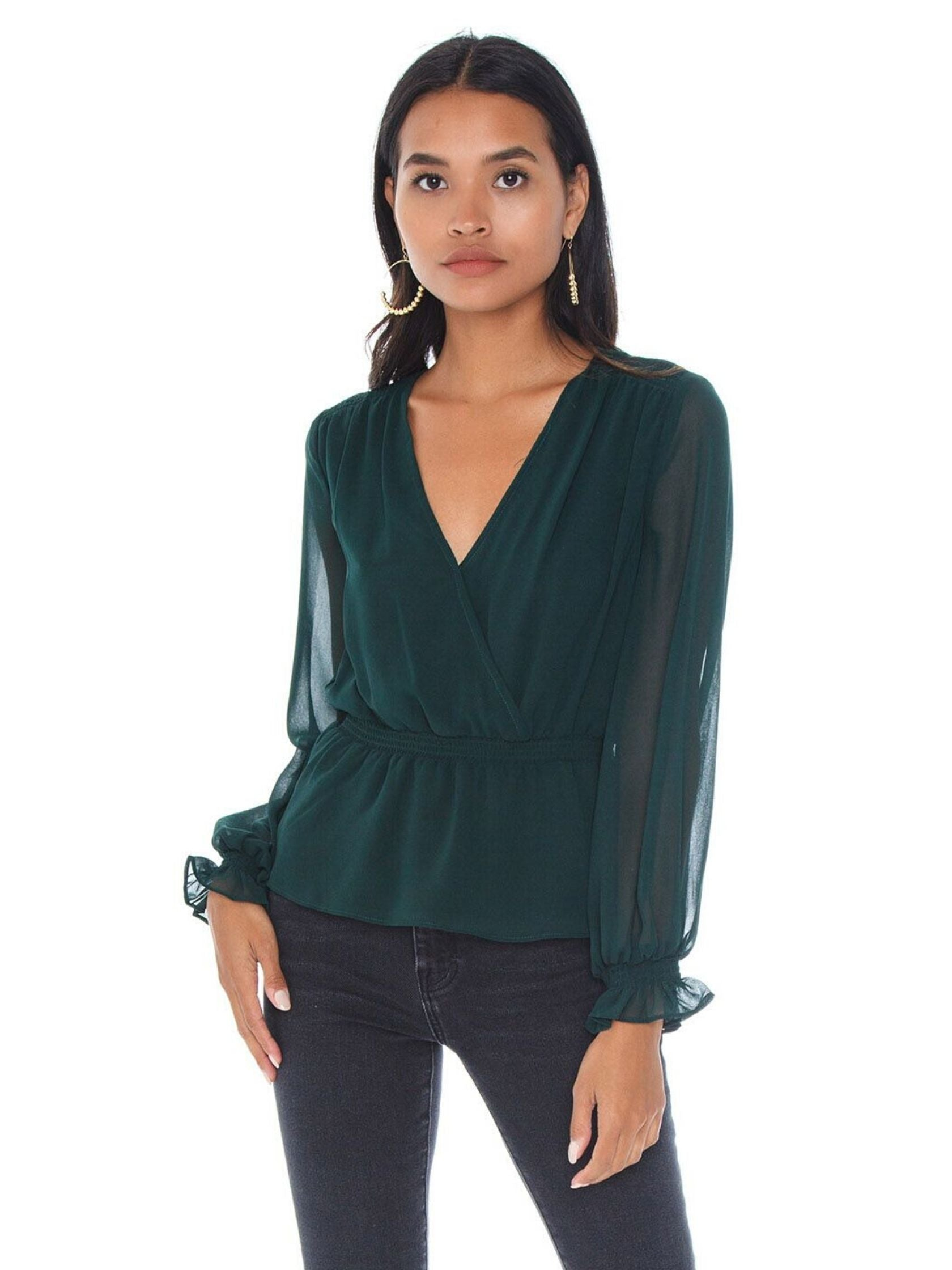Woman wearing a top rental from 1.STATE called Cinched Waist Wrap Front Blouse
