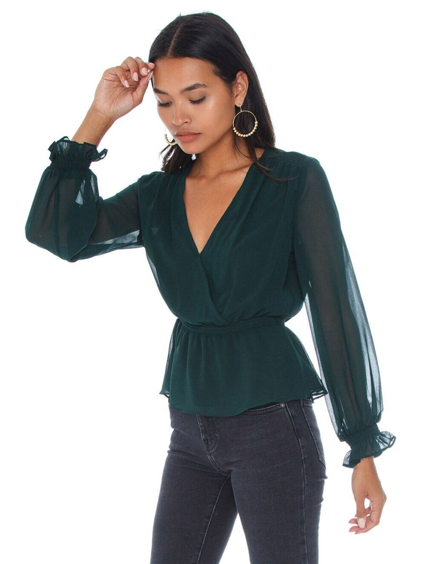 Women wearing a top rental from 1.STATE called Cinched Waist Wrap Front Blouse