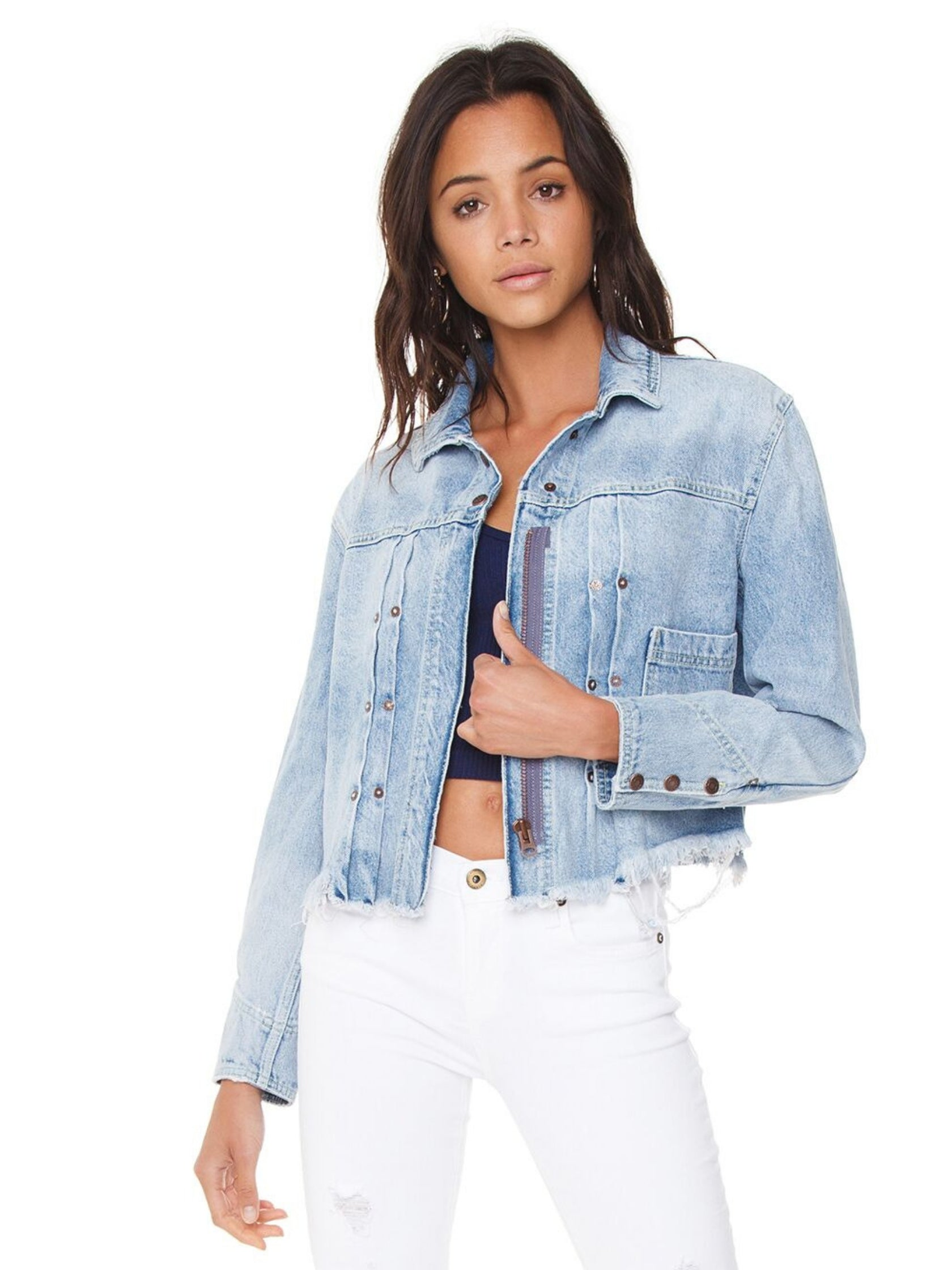 Woman wearing a jacket rental from Free People called Dillon Denim Jacket