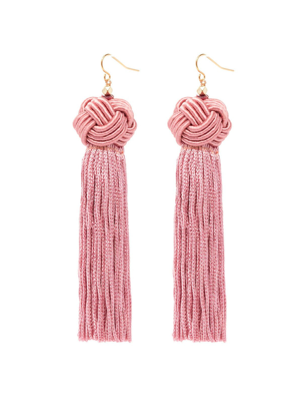 Women outfit in a earrings rental from Vanessa Mooney called The Astrid Knotted Tassel Earrings