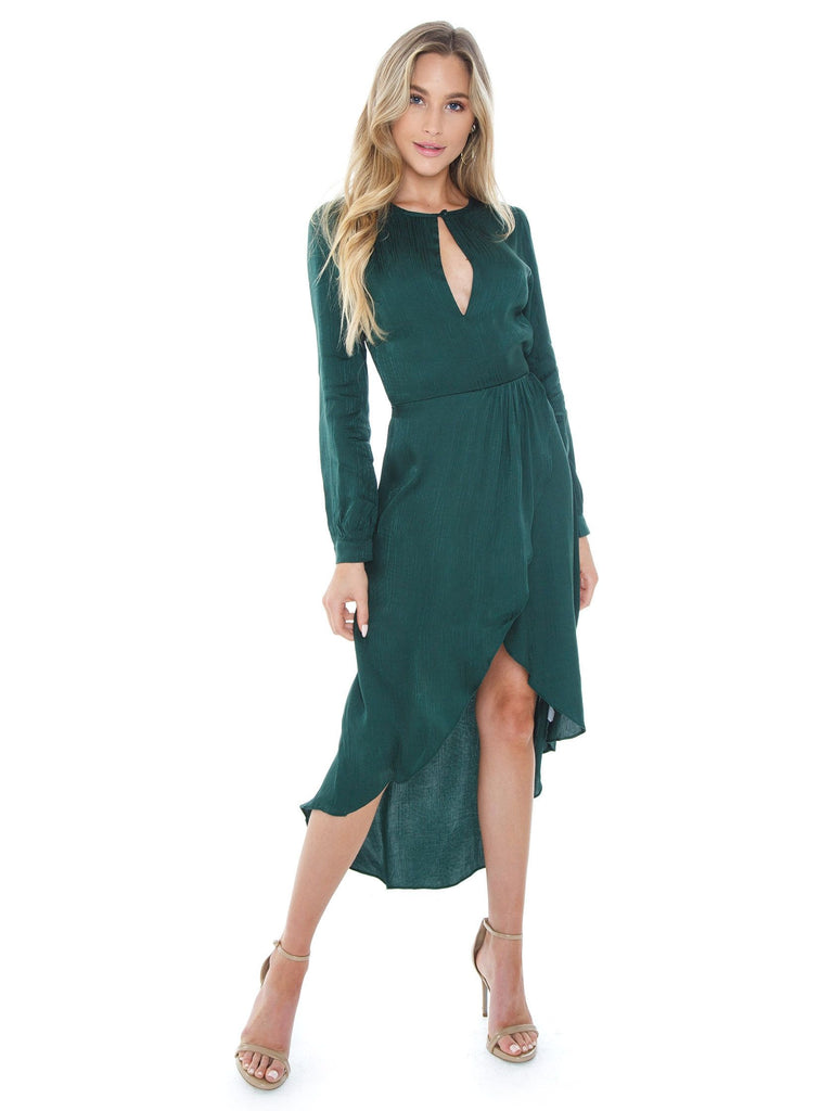 Woman wearing a dress rental from Blue Life called Cinched Sleeve Woodland Ditsy Wrap Dress