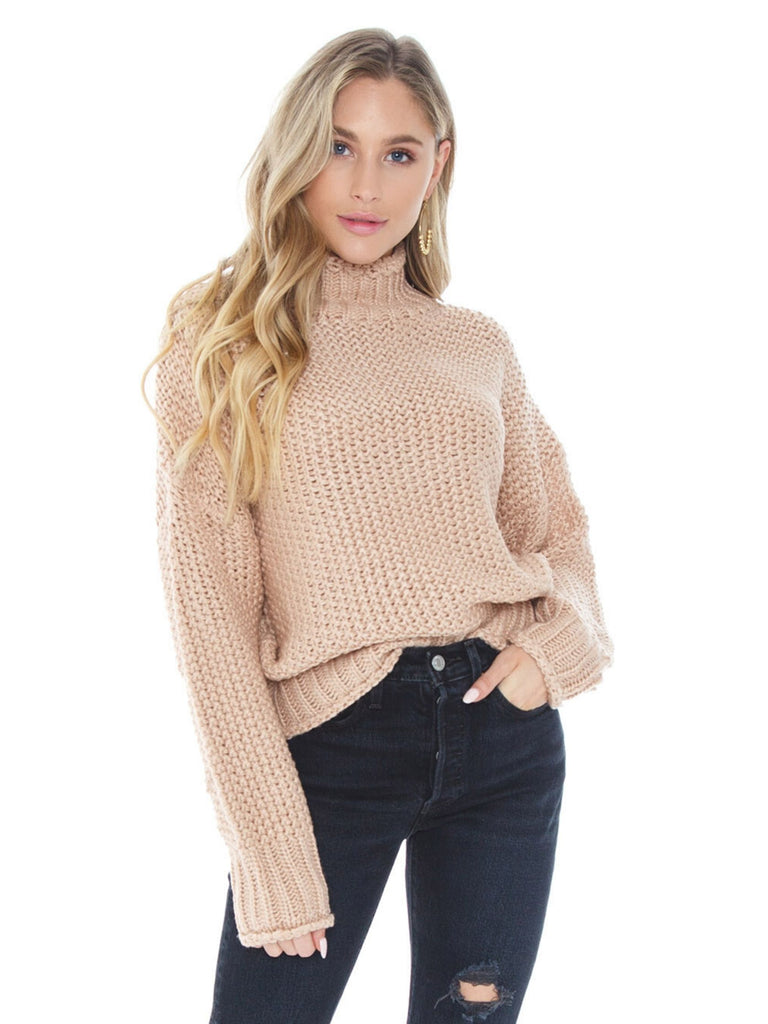 Women outfit in a sweater rental from FashionPass called Elle Long Sleeve Snap Front Shirt