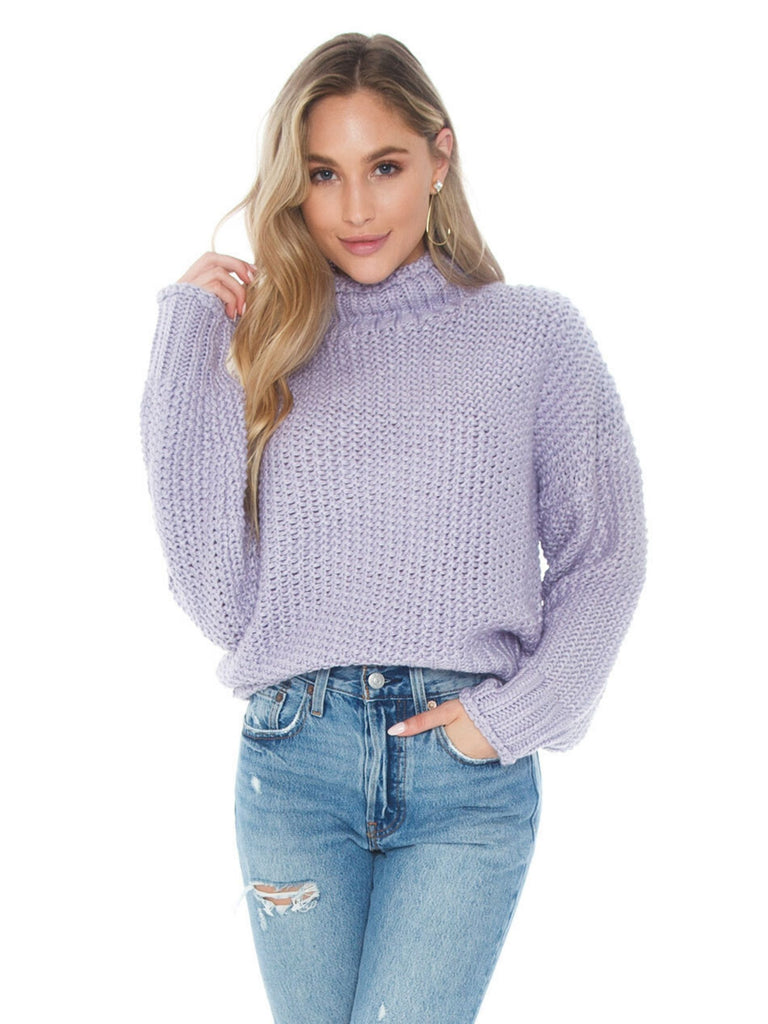 Women wearing a sweater rental from FashionPass called Say It To Me Bodysuit