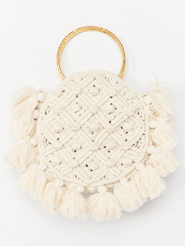 Girl wearing a purse rental from Show Me Your Mumu called Cropped Varsity Vacay Sweater