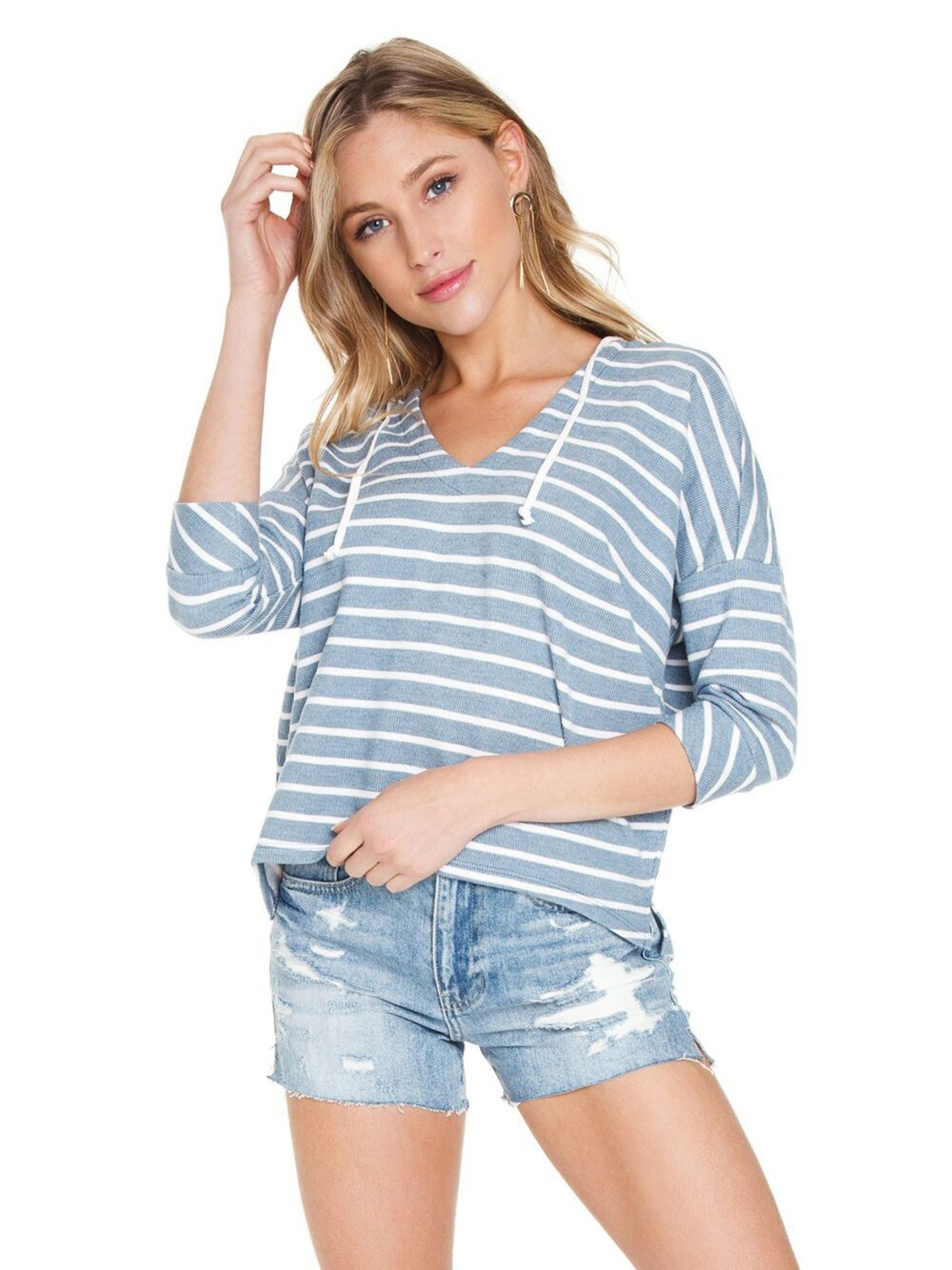 Woman wearing a top rental from Chaser called French Terry Striped 3/4 Sleeve Side Split Pullover