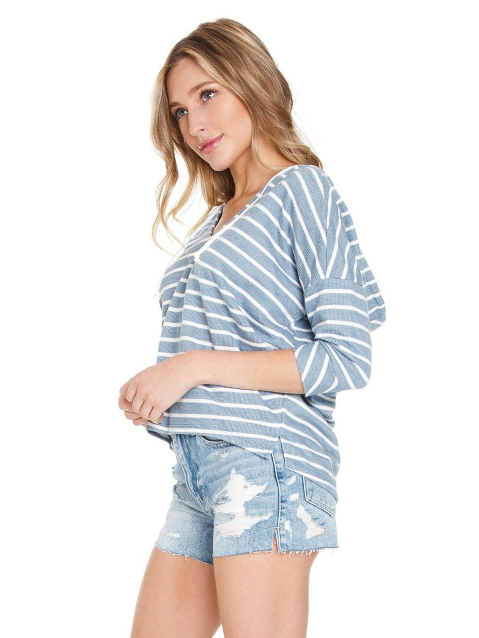 Women wearing a top rental from Chaser called French Terry Striped 3/4 Sleeve Side Split Pullover