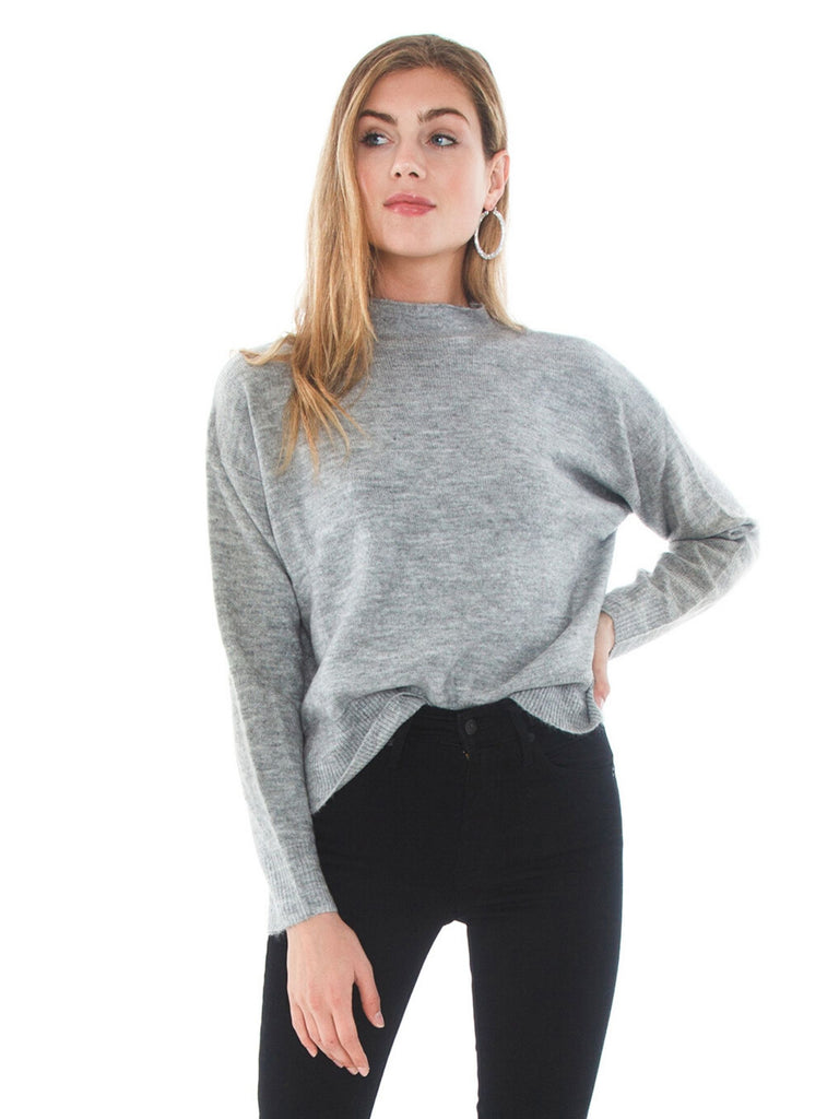 Girl wearing a sweater rental from MINKPINK called Lana High Neck Blouse