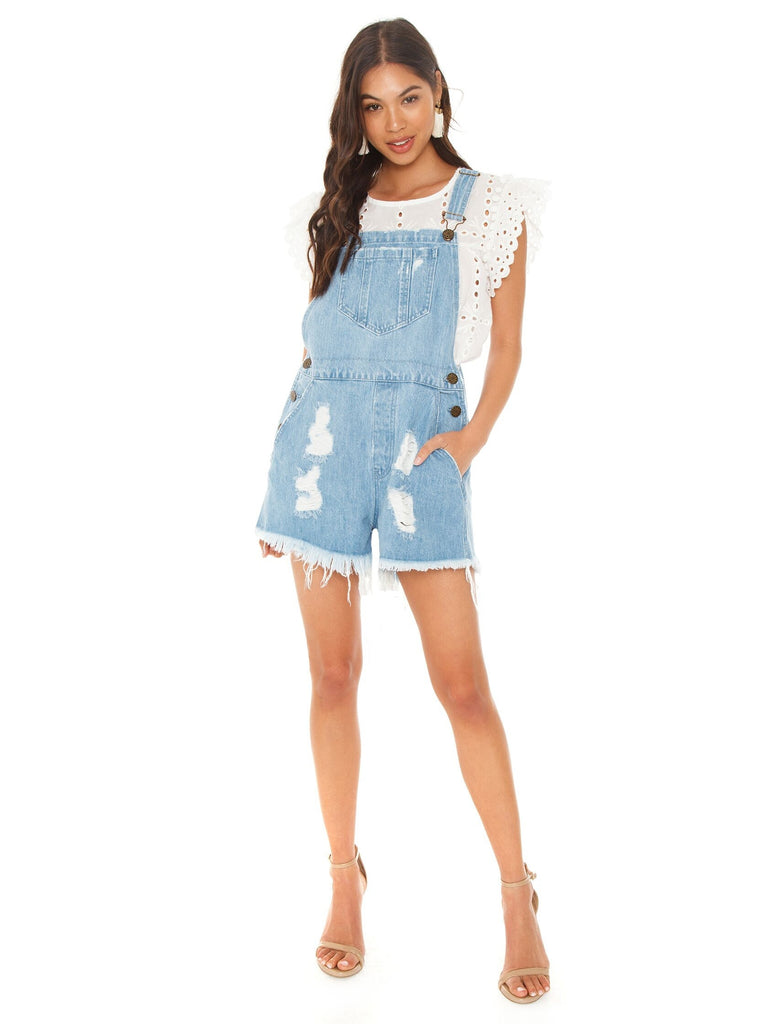Girl wearing a overalls rental from Show Me Your Mumu called Zion Jumpsuit