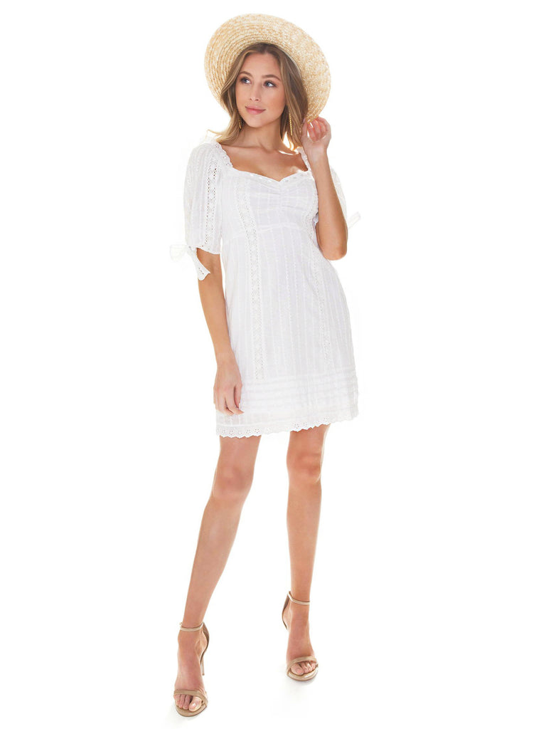 Girl wearing a dress rental from Show Me Your Mumu called Ruffle Cold Shoulder Dress