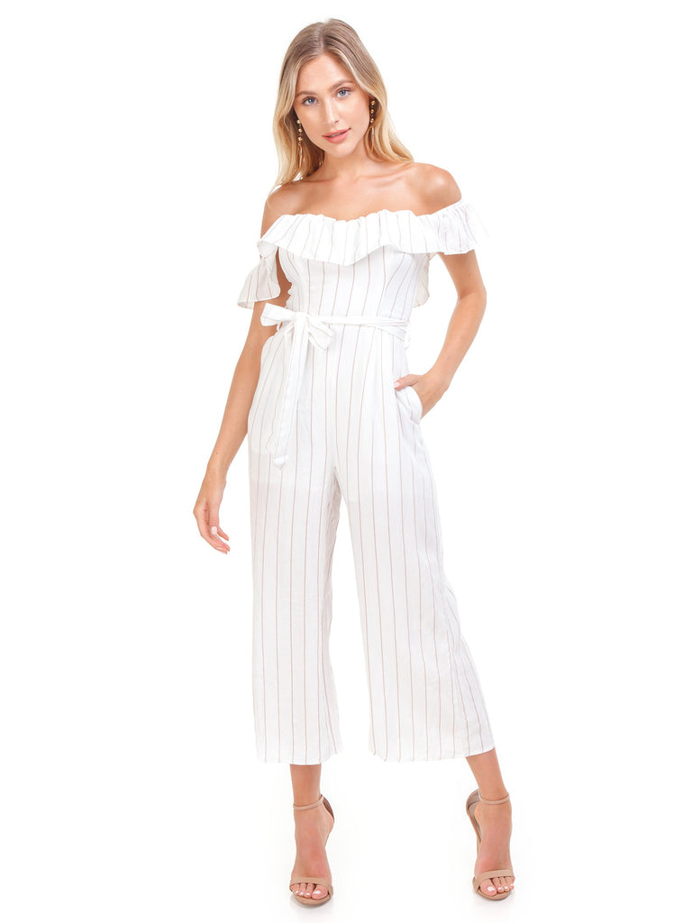 Woman wearing a jumpsuit rental from ASTR called Dance Till Dawn Romper