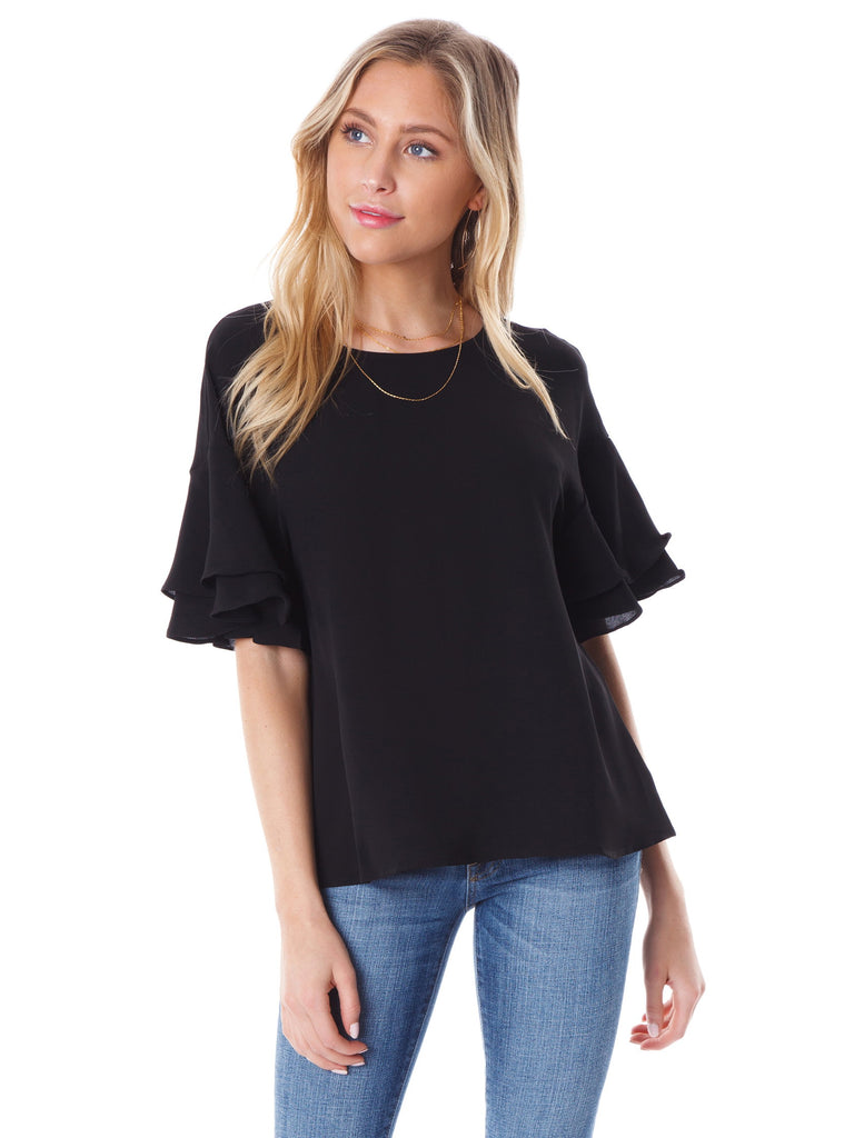 Girl wearing a top rental from Lush called V-neck Ruffle Sleeve Top