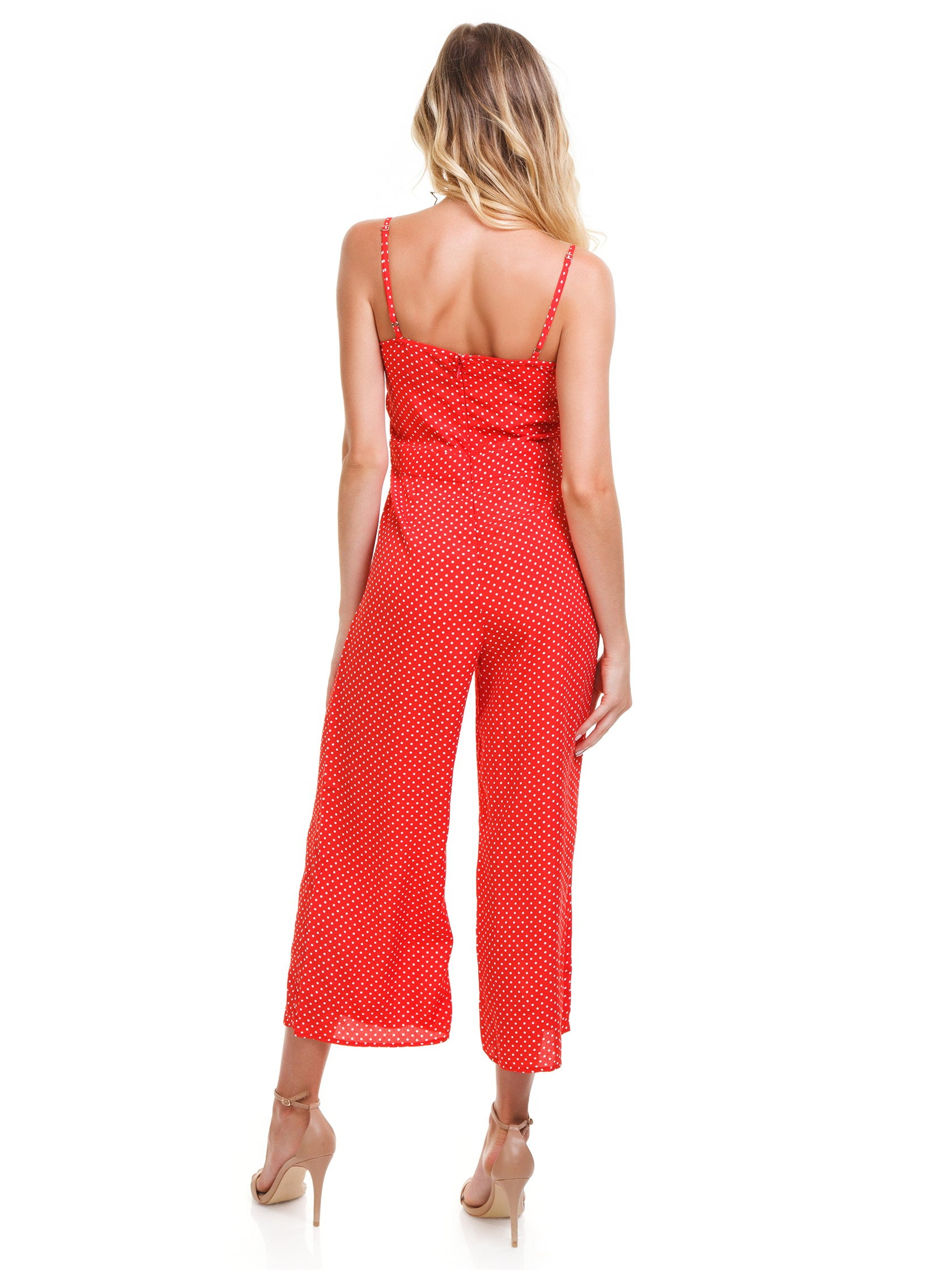 Women wearing a jumpsuit rental from Blue Life called Tied Up Jumpsuit