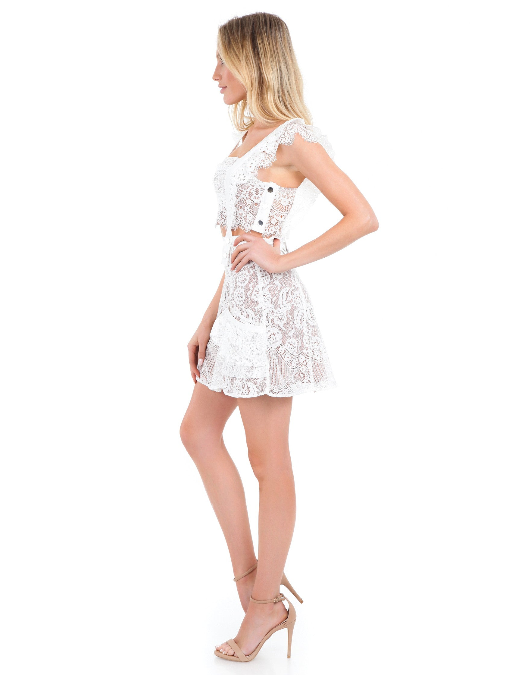 Women outfit in a dress rental from For Love & Lemons called Tati Pinafore Lace Dress