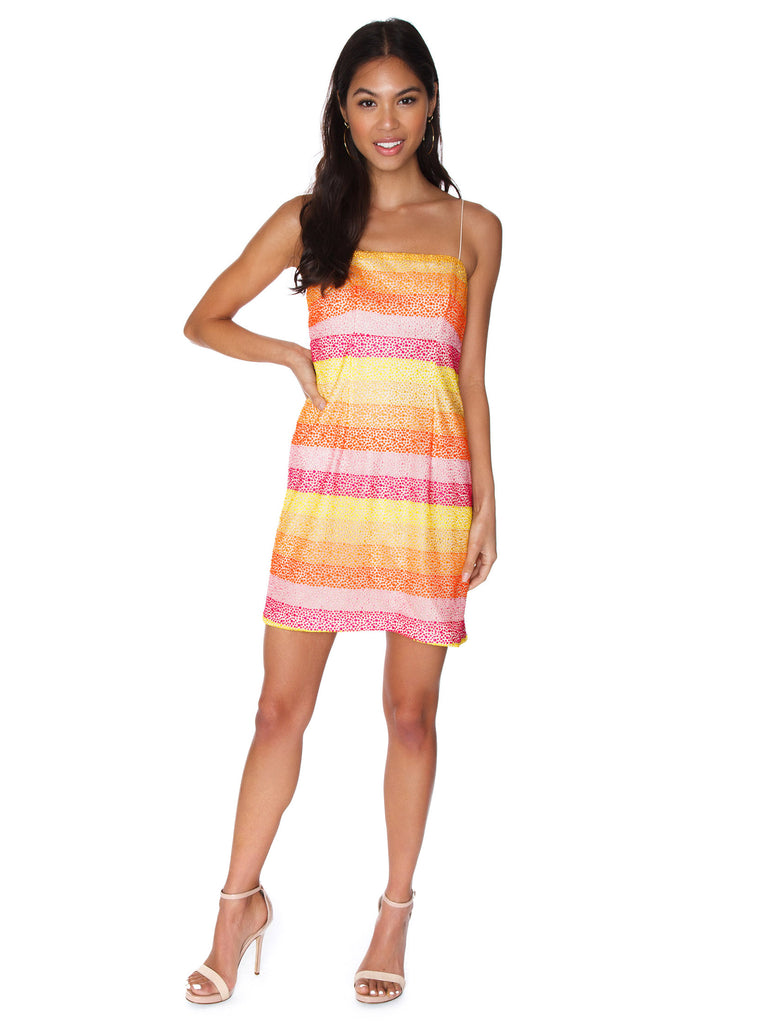 Woman wearing a dress rental from Show Me Your Mumu called Love Print Mini