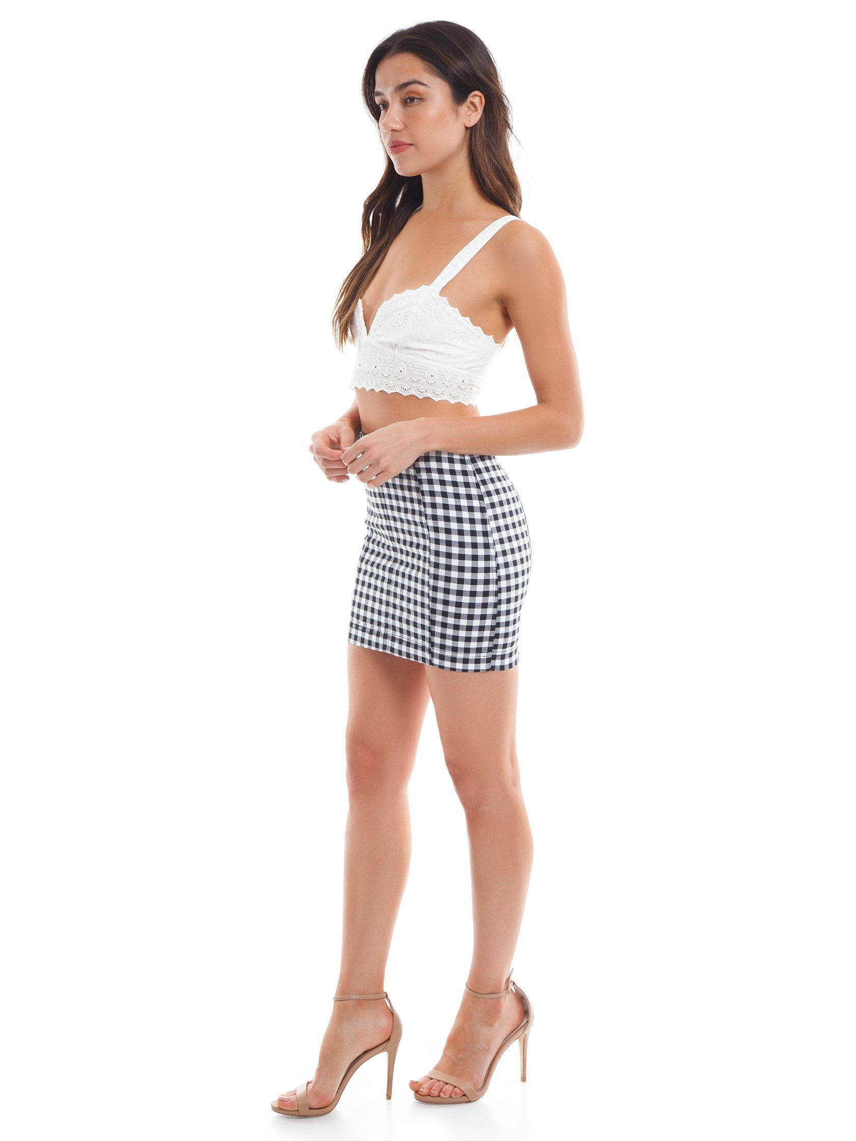 Woman wearing a skirt rental from Free People called Modern Femme Gingham Mini Skirt