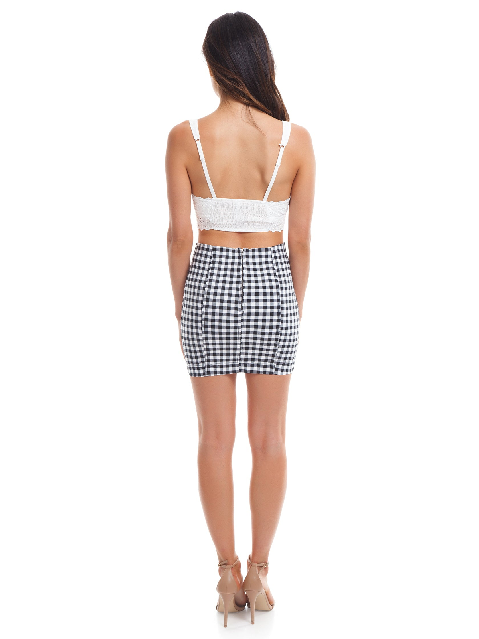 Women wearing a skirt rental from Free People called Modern Femme Gingham Mini Skirt