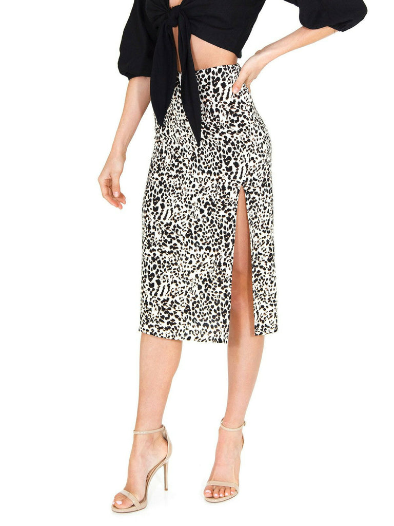 Woman wearing a skirt rental from FASHIONPASS called Leopard Midi Dress
