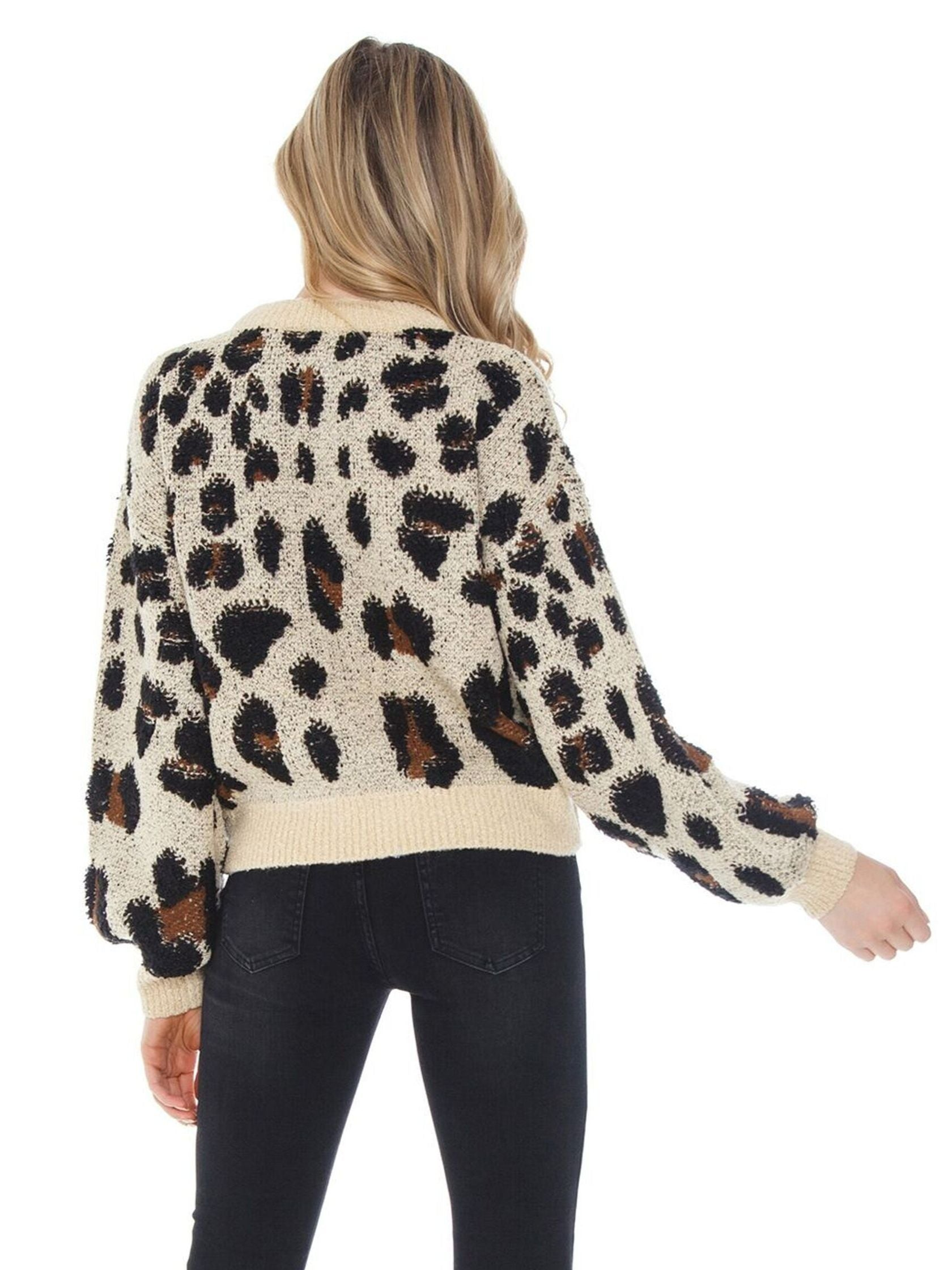 Women outfit in a sweater rental from BARDOT called Leopard Slouch Knit