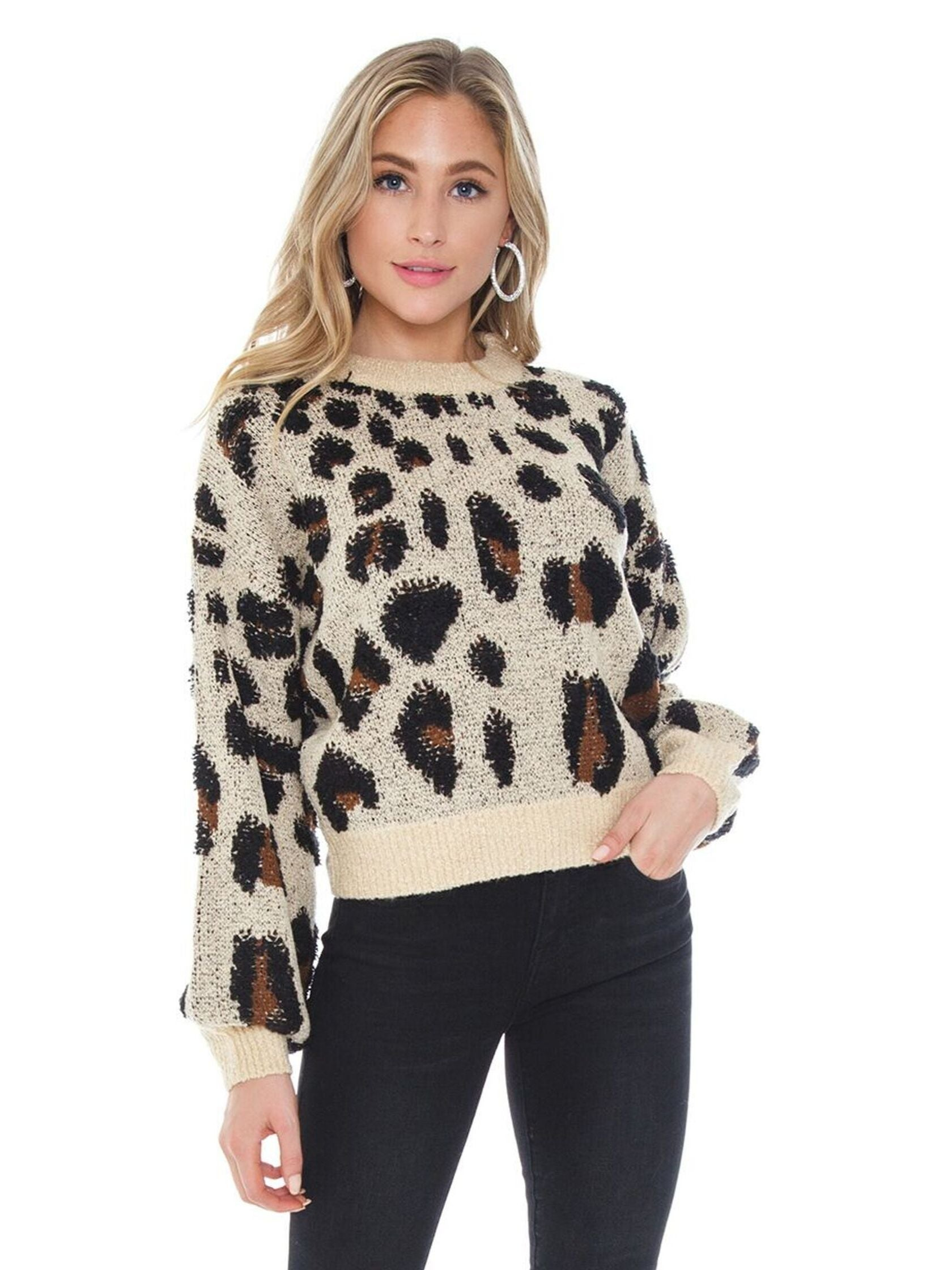 Woman wearing a sweater rental from BARDOT called Leopard Slouch Knit