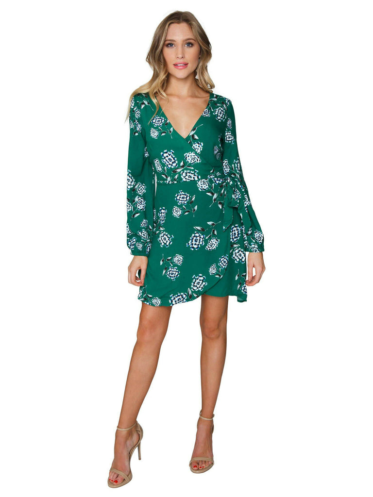 Girl wearing a dress rental from Cupcakes and Cashmere called Velvet Flutter Sleeve Wrap Dress