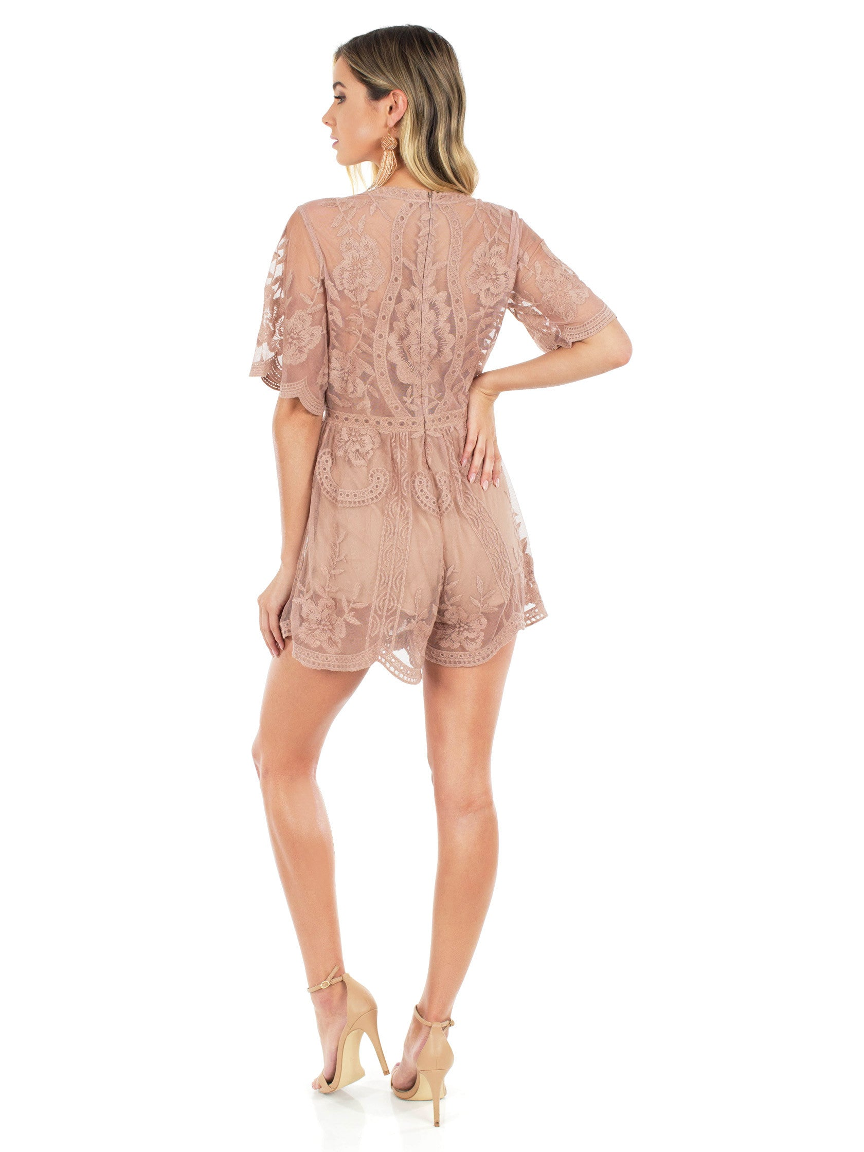 Women wearing a romper rental from FashionPass called Breaking Hearts Romper