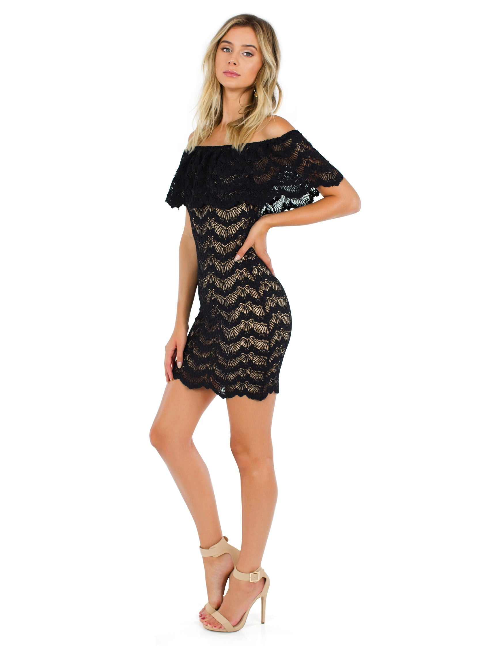 Woman wearing a dress rental from Nightcap Clothing called Bachelorette Mini Dress