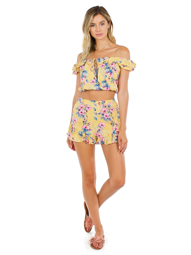 Girl wearing a two piece rental from FashionPass called Take Me To Tulum Romper