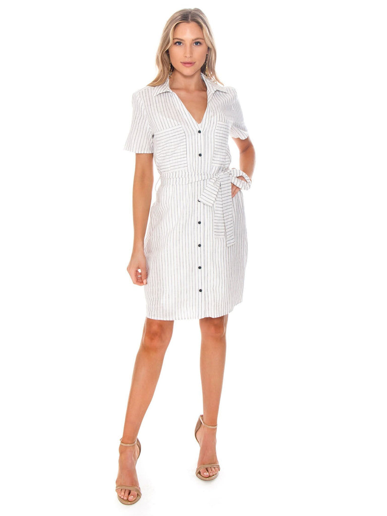 Women wearing a dress rental from 1.STATE called Layla Mini Spot Wrap Dress