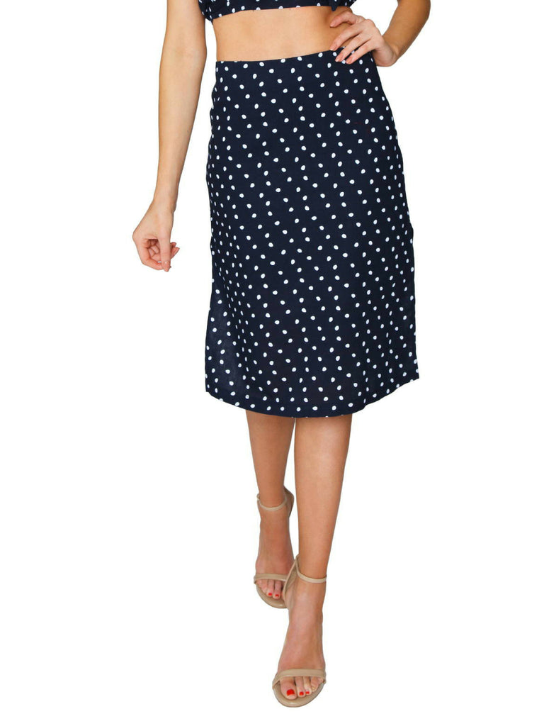 Woman wearing a skirt rental from MINKPINK called Aloha Cove Waist Tie Dress