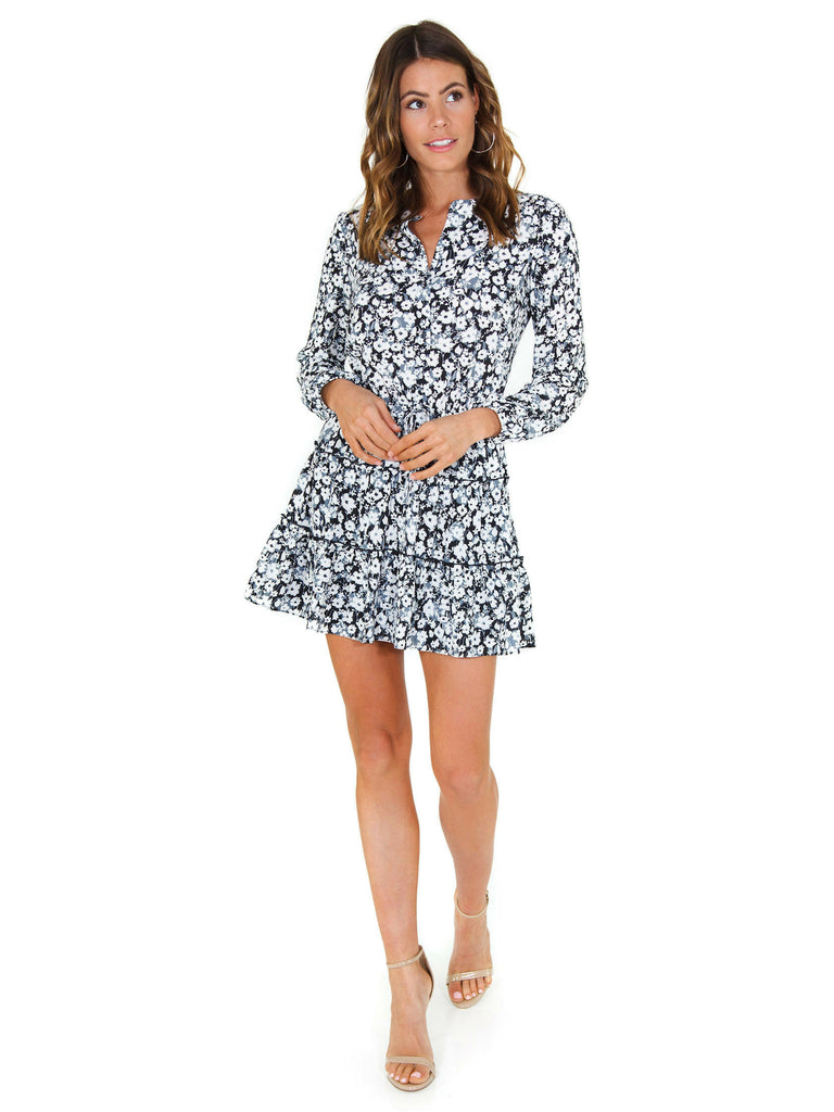 Woman wearing a dress rental from 1.STATE called Cinched Sleeve Woodland Ditsy Wrap Dress
