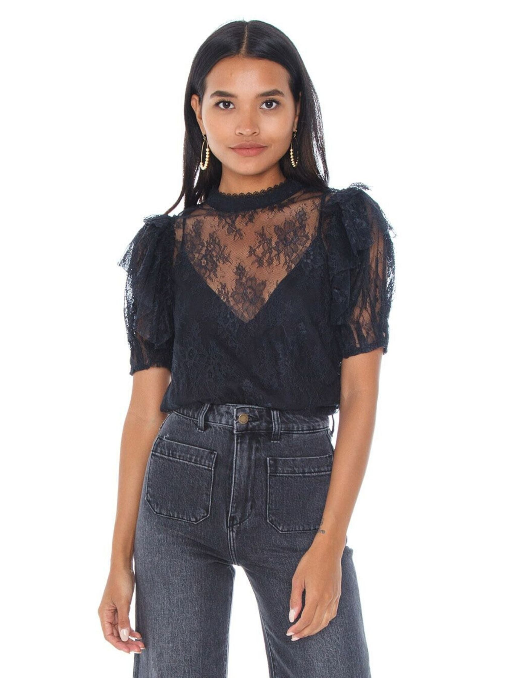 Woman wearing a top rental from Free People called Secret Admirer Blouse