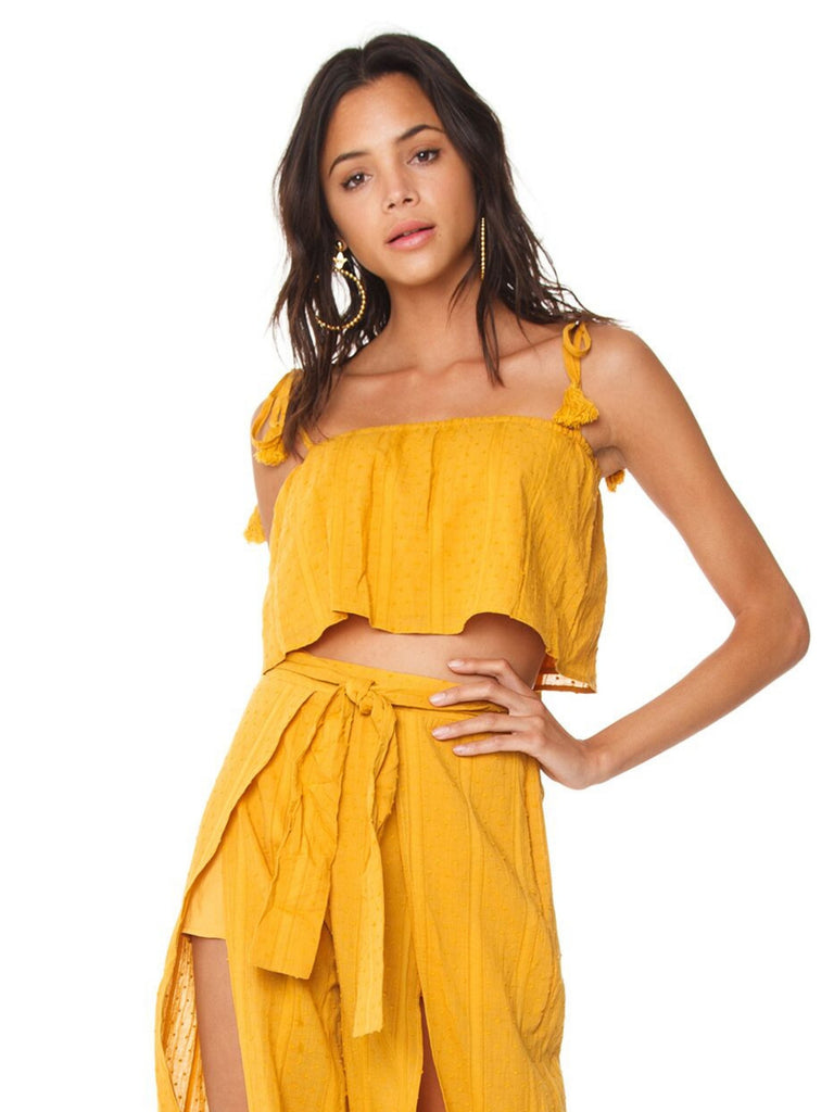 Girl wearing a top rental from MINKPINK called Ruffle Cold Shoulder Dress