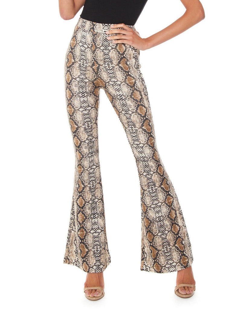 Women wearing a pants rental from FASHIONPASS called Snake Charmer Pants