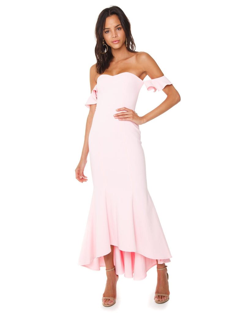 Women wearing a dress rental from LIKELY called Sunset Gown