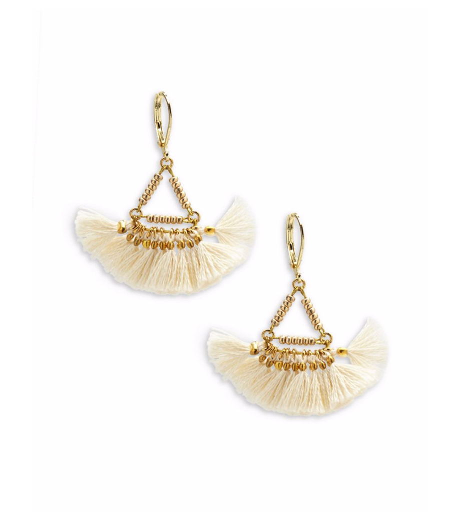 Women wearing a earrings rental from Shashi called Lilu Tassel Earring