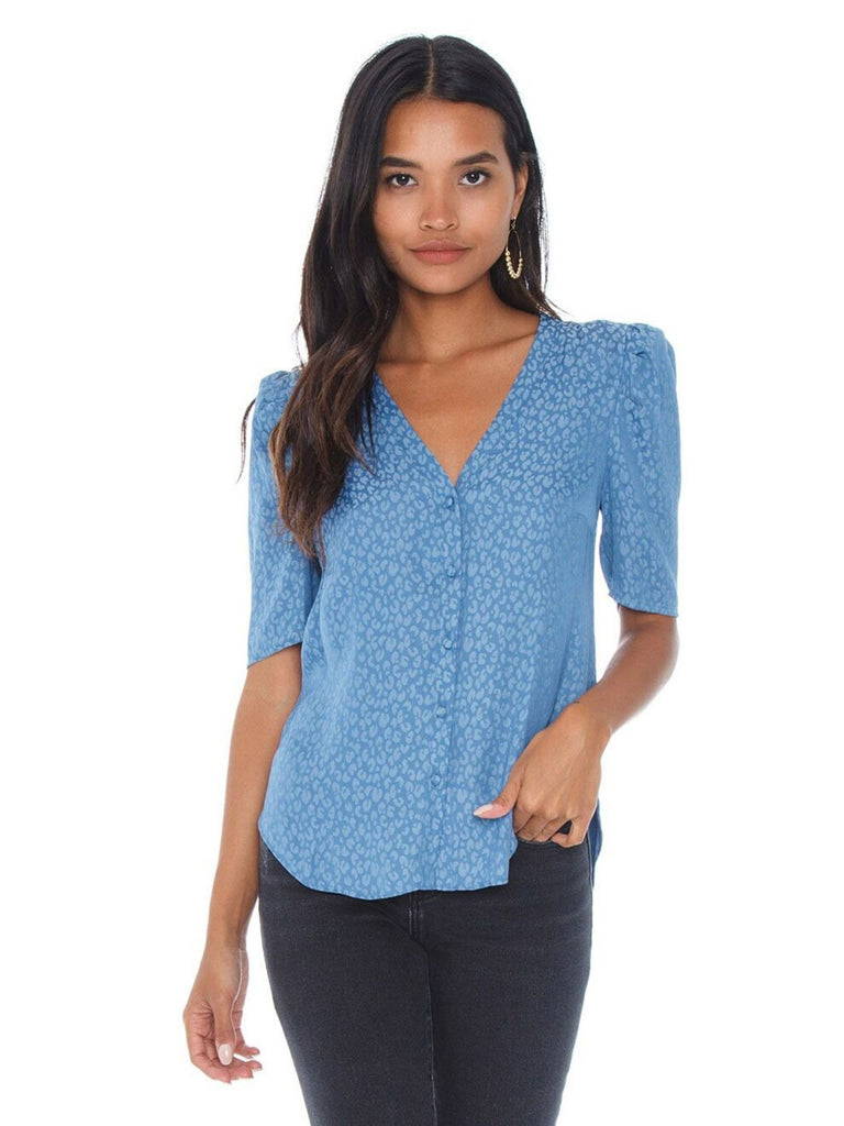 Girl wearing a top rental from 1.STATE called Tie Neck Smocked Waist Blouse