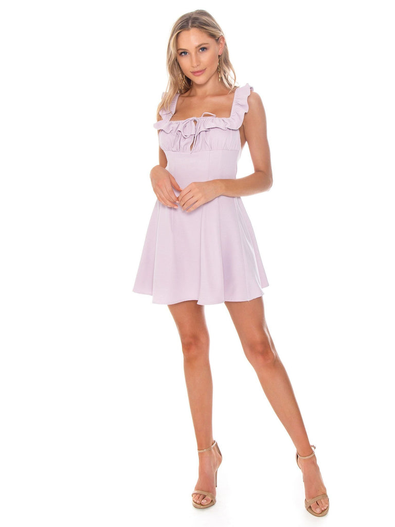 Girl outfit in a dress rental from Lani The Label called Ruffle Cold Shoulder Dress