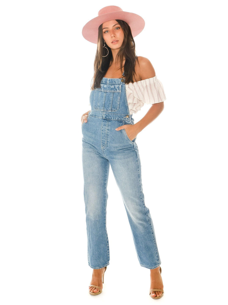 Girl wearing a overalls rental from ROLLAS called Vacay Vibes Romper