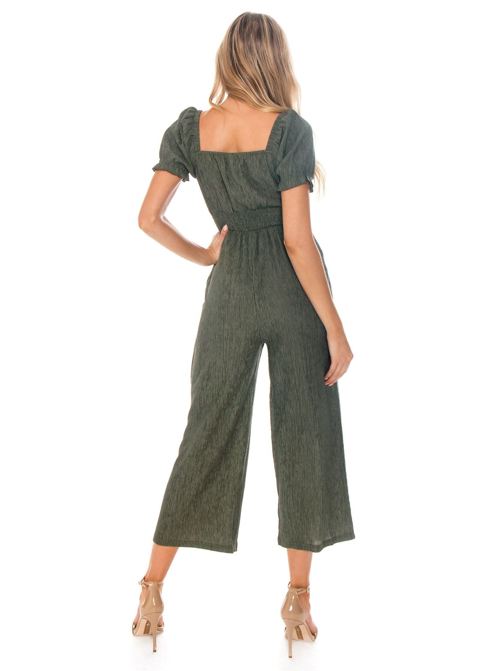 Girl wearing a jumpsuit rental from MINKPINK called Twist Front Jumpsuit