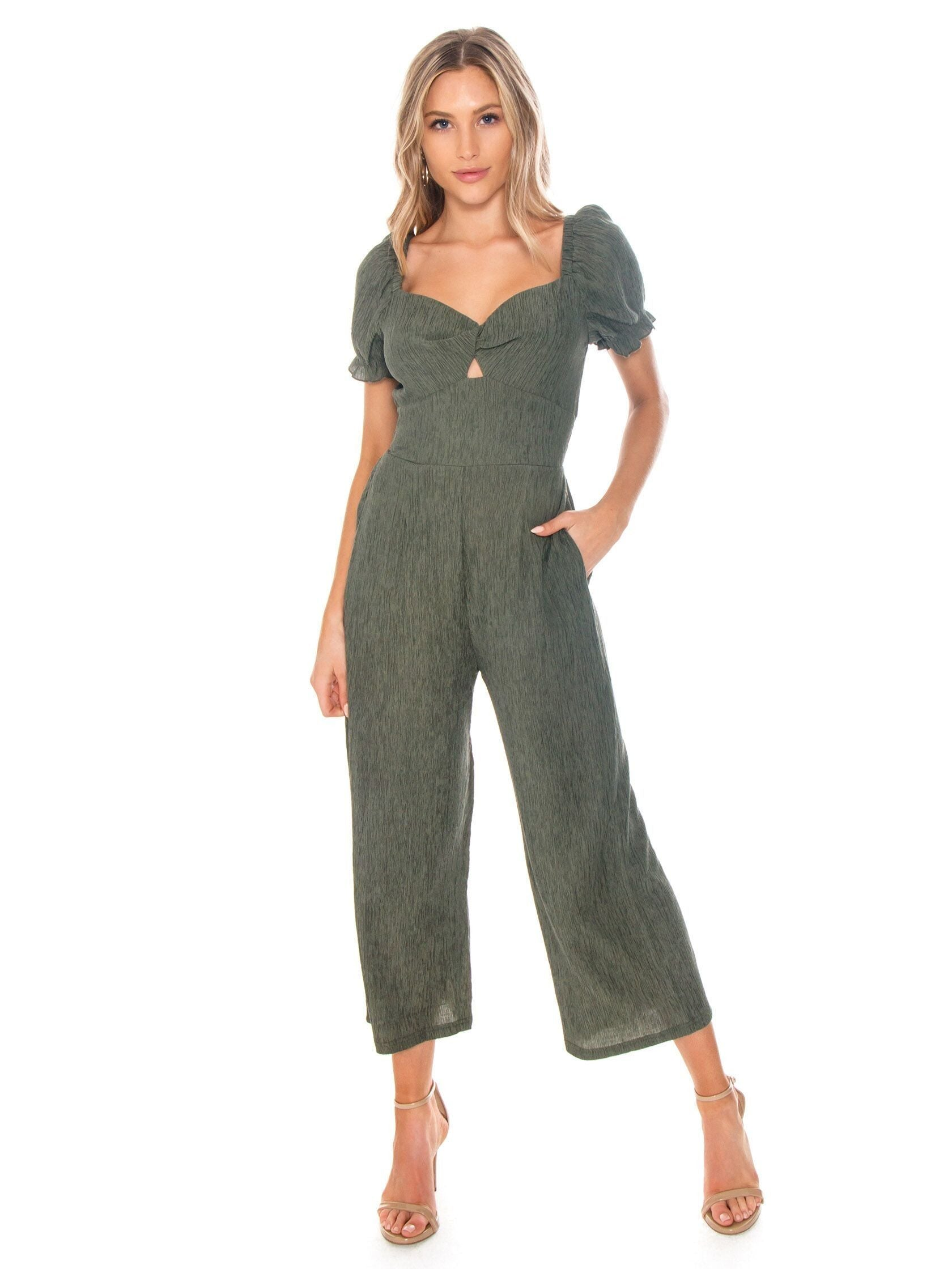 Woman wearing a jumpsuit rental from MINKPINK called Twist Front Jumpsuit