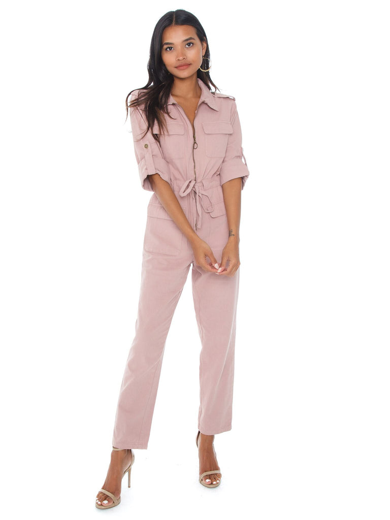 Girl wearing a jumpsuit rental from MINKPINK called Lana High Neck Blouse