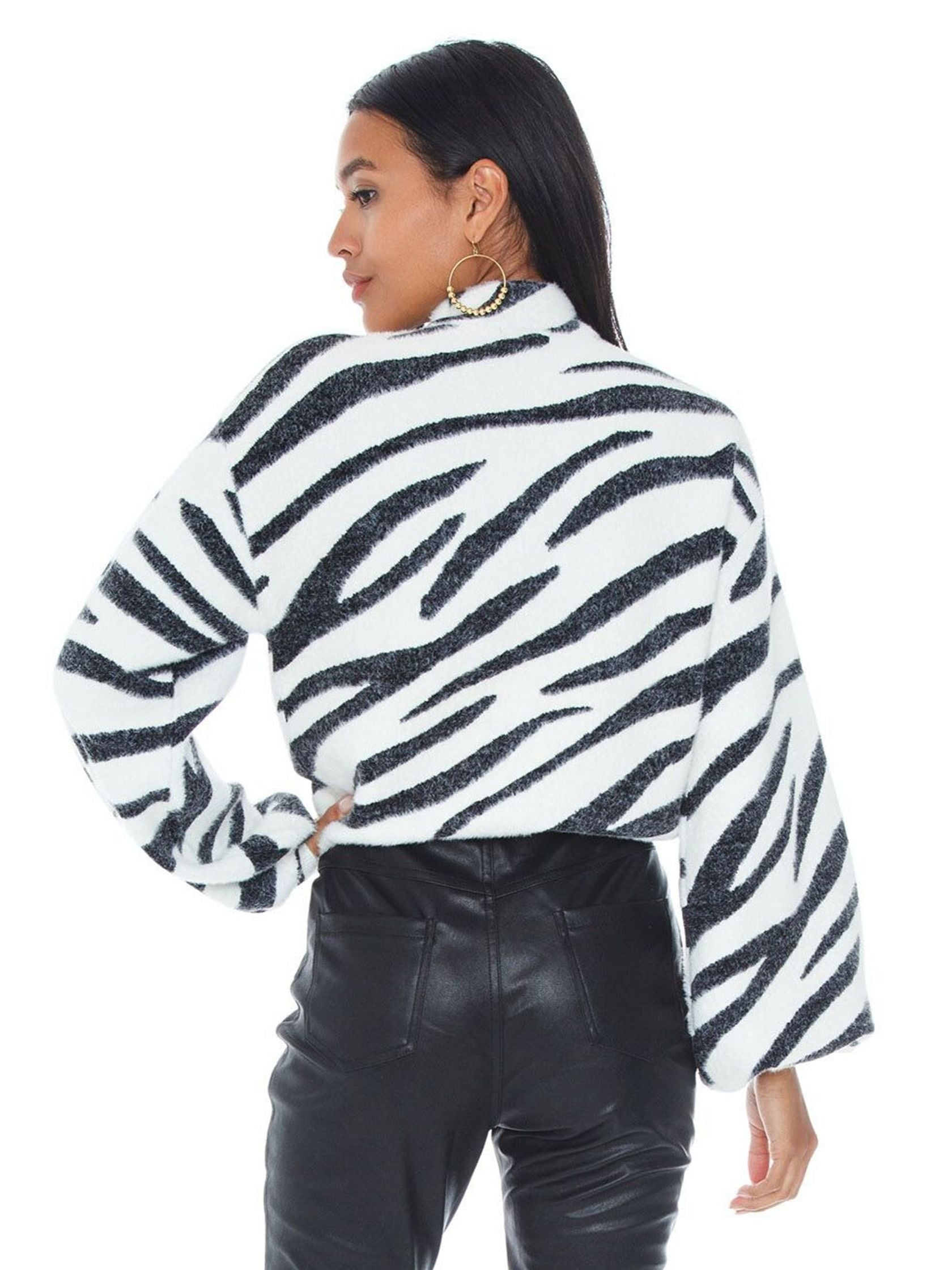 Women outfit in a sweater rental from BARDOT called Zebra Knit Jumper