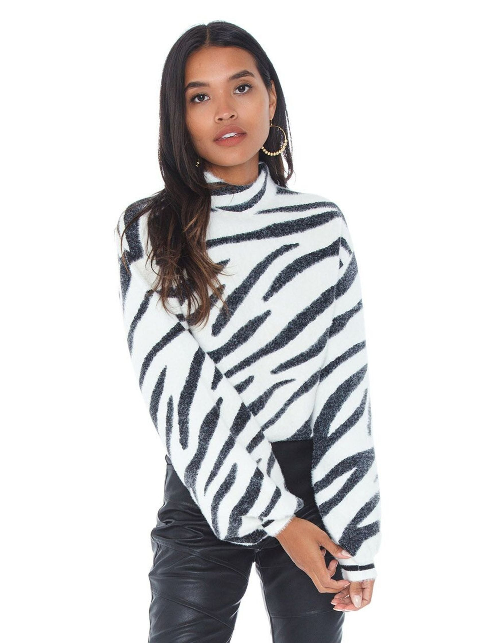 Woman wearing a sweater rental from BARDOT called Zebra Knit Jumper