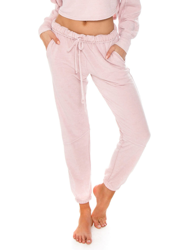 Women wearing a pants rental from Free People called Zuma Sweatpants