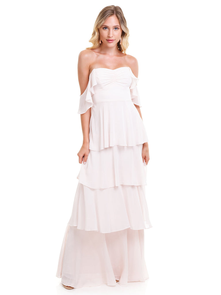 Girl wearing a dress rental from WAYF called Gwyneth Ruffle Maxi Dress