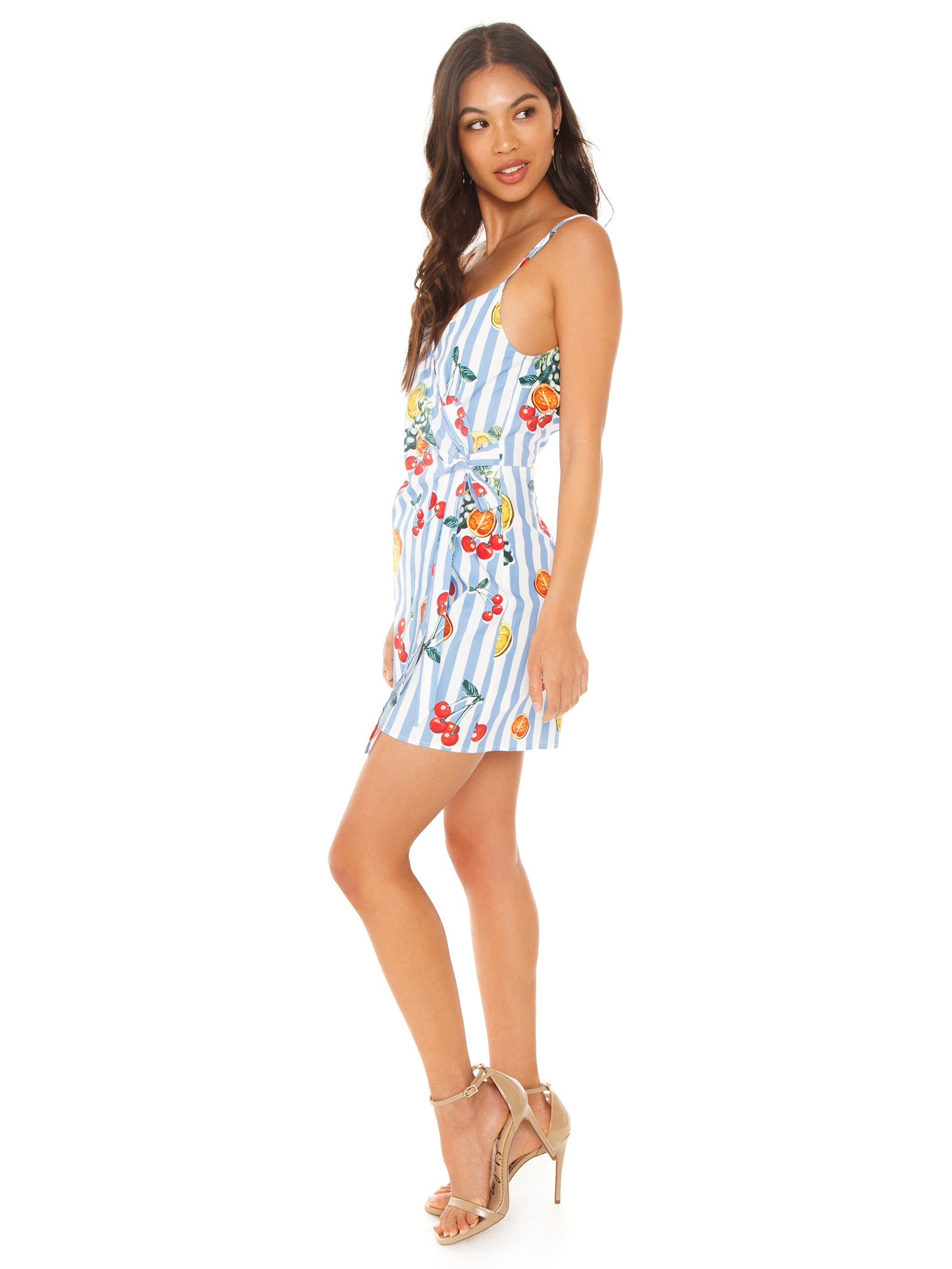 Woman wearing a romper rental from Show Me Your Mumu called Addison Romper