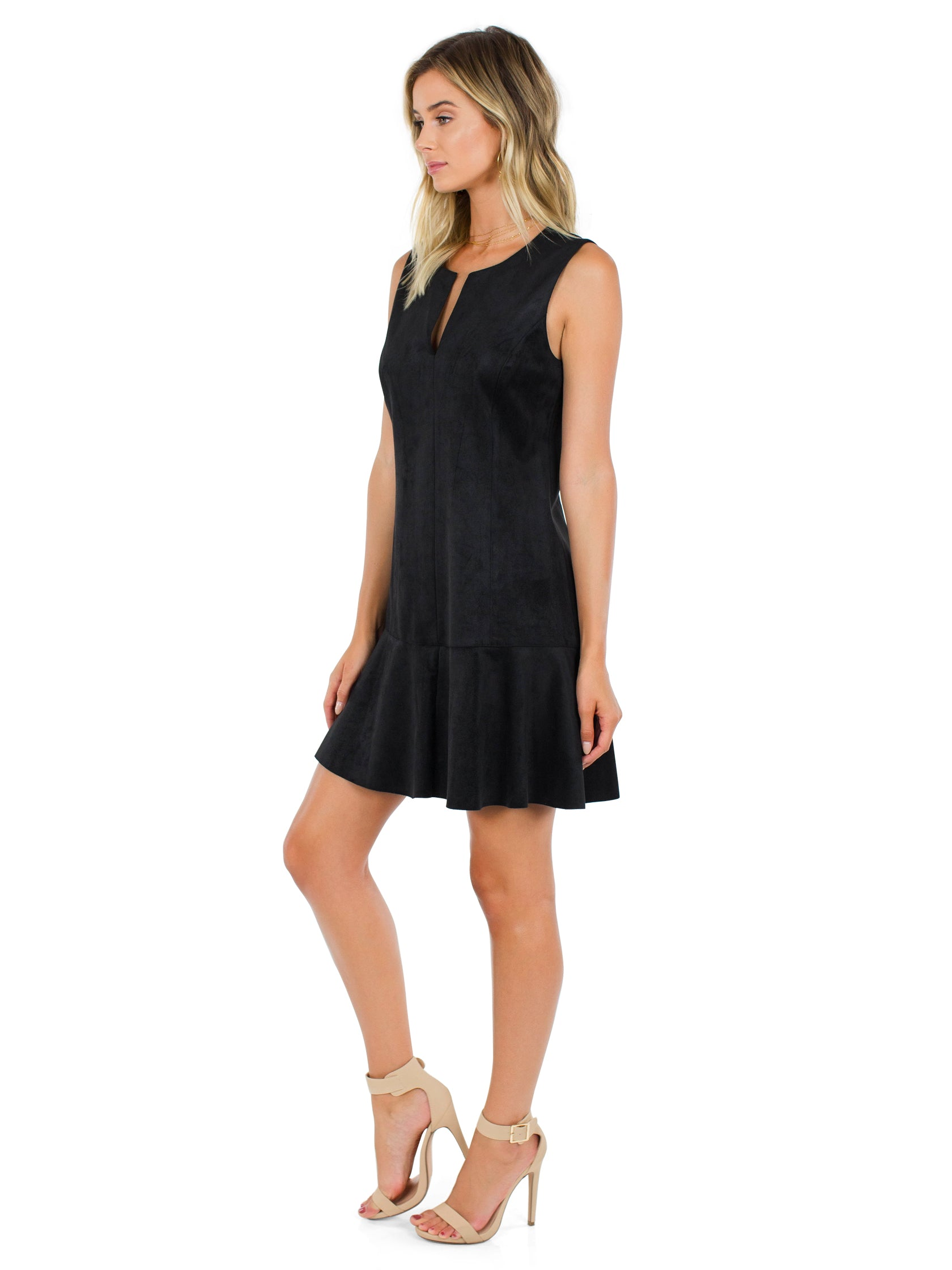 Woman wearing a dress rental from BCBGMAXAZRIA called Adelene Faux-suede Dress